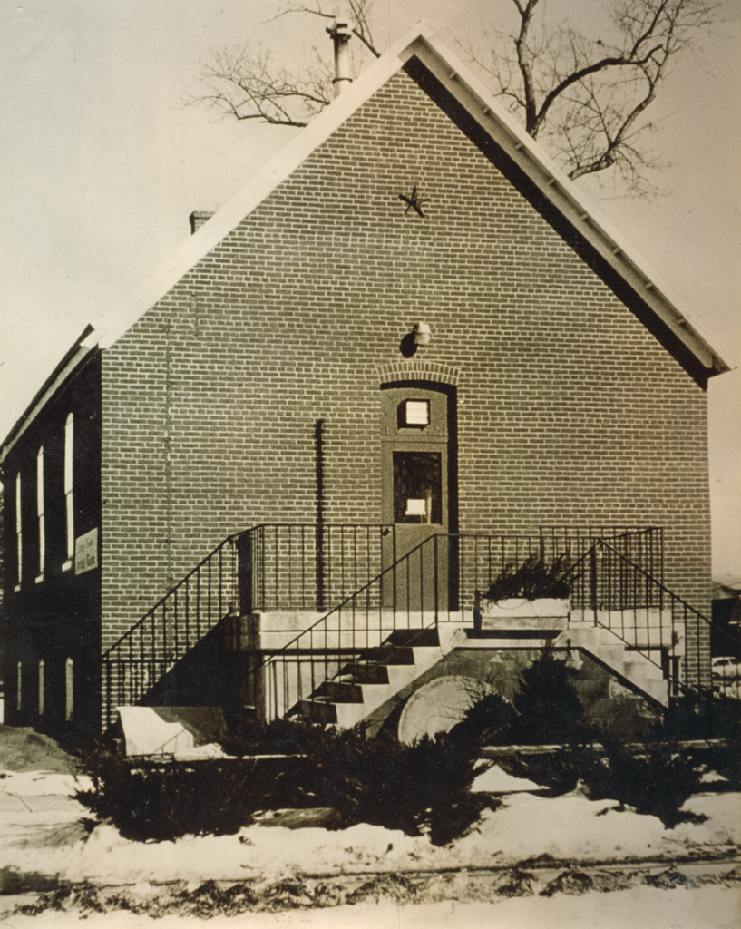 Pictured is the old Coralville City Hall; the library was located in the basement. Citation: Coralville Public Library. (2021). History of the Coralville Public Library. Retrieved from http://coralvillepubliclibrary.org/about/history-coralville-public-library
